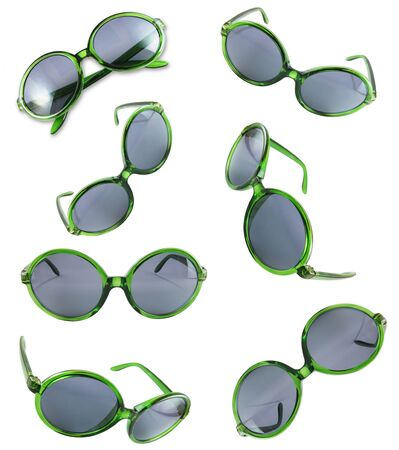 Set of green sunglasses isolated on the white background  Stock Photo - 10057141
