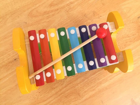 texture: Melody xylophone on wood background.