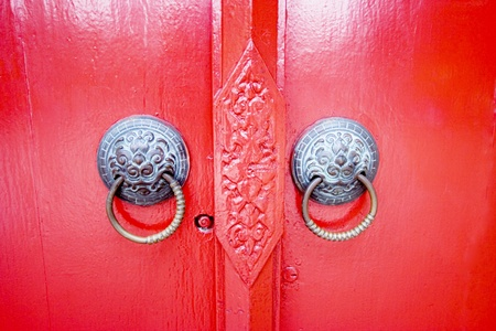 Old thai latch with red door photo