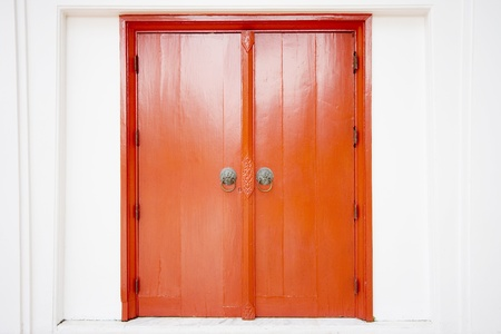 Old thai door with single traditional asian red wooden door closed  photo