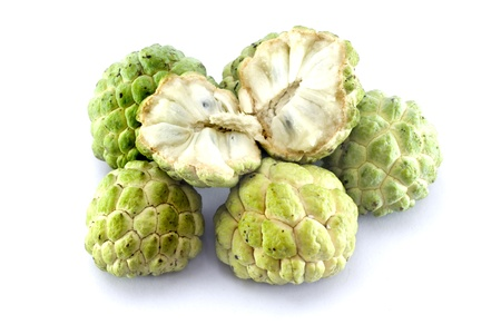 Custard apples group and  opened one on white background with isolate. photo