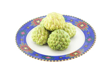 Custard apples group and  opened one on a plate with isolate wihite background. Stock Photo - 10323431