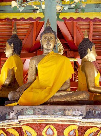 godhead: Three golden sitting Buddha  in temple , Thailand