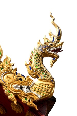 Naga on Thai temple roof in the northern of Thailand with isolate white background   photo