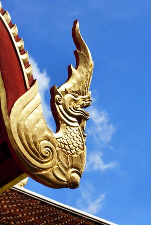 Naga Thai roof of a temple in the northern of Thailand   photo