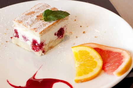 Cake with fruit on a plate in French  photo