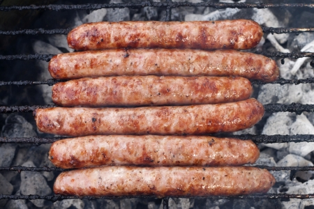 Sausages on grill closed-up, barbecue party  Stock Photo - 13769004