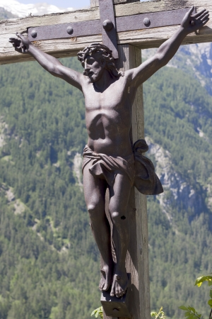 inri: Christ Jesus hangs on a wooden cross, Grenoble, France