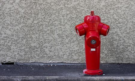 Fire hydrant on the wall background  photo