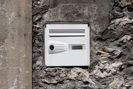 The postal drop box on the stone mason wall   photo