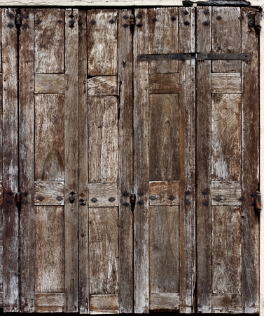 rusty nail: Old wooden barn windows in Grenoble, France