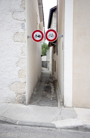 bycicle: Cycling sign and bycicle part way in France.