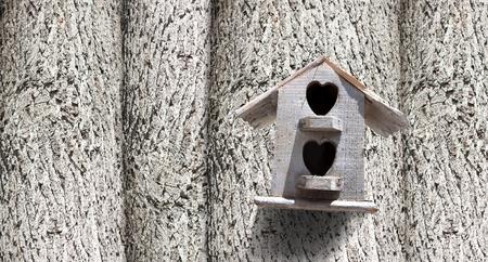 bird house: Bird house with the entrance hole with trees.