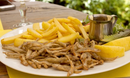 sprat: Small fish fried and chips on the table Stock Photo