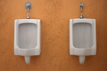 White urinals in the public restroom. photo