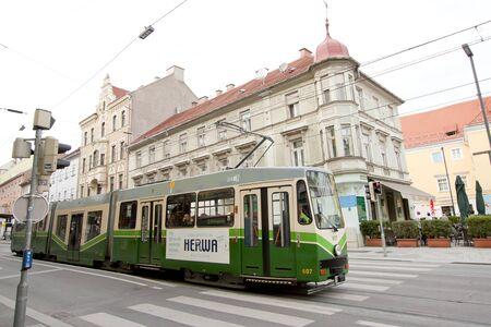 GRAZ, AUSTRIA - OCT 6: A green tram in the centre of Graz city on Oct 6, 2017 in Graz, Austria.