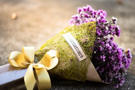 Congratulation purple flower bouquet on the floor