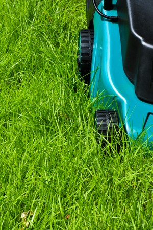 Lawn mover is going to be operated over long grass with front side view Stock Photo - 7120022