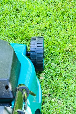 mover: Lawn mover finished operating until short grass with backside view