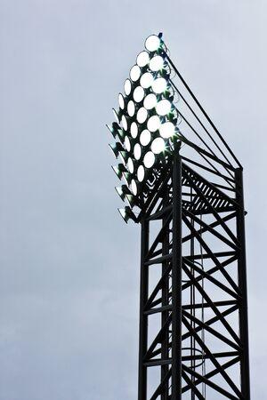 Spotlight of football stadium is lighting up under hard cloud photo