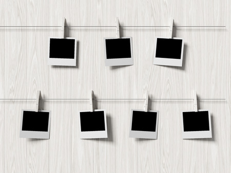 empty polaroid photos frames on wood background, concept art