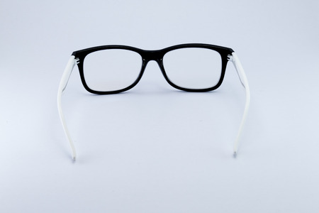 formal dressing: Black glasses to improve eyesight isolated on white background, object isolate