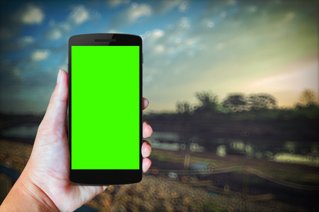 mobile phone screen: Modern mobile phone in the hand,on blur background image Stock Photo