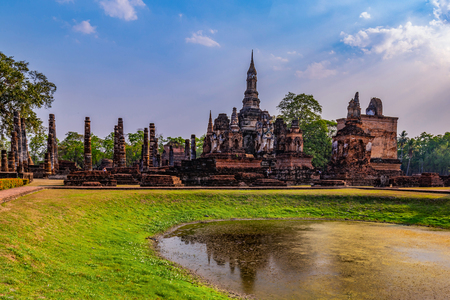 Sukhothai historical park and surrounding area in the midday and twilight Reklamní fotografie