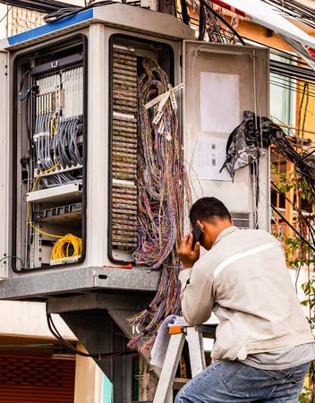 Telephone technician checks the coaxial cable Reklamní fotografie