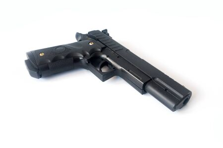 Close up of a generic hand pistol against white background. It is a dangerous weapon made to kill.