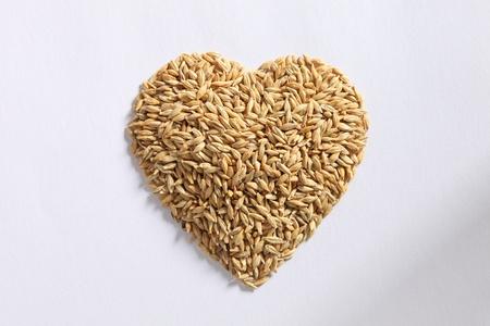 malt: barley seed pile HeartShape Stock Photo
