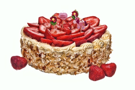 strawberry almond birthday cake with four childish candles, nobody, isolated over white, brightly lit photo