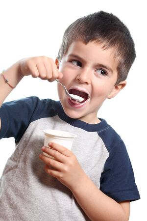 kids eat: young boy eat yougurt