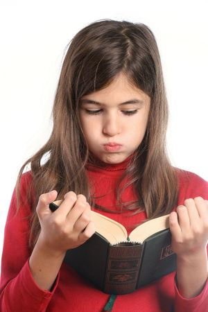 listless: little girl bored reads a book Stock Photo