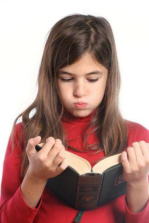 listless: little girl bored reads a book Stock Photo