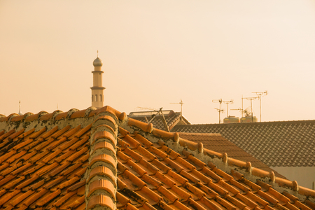 rooftile: mosque tower with tile roof top photo taken in depok jakarta indonesia