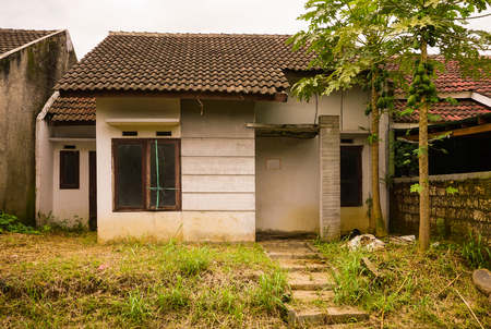abandon: abandon house not maintained with bush and small plant grow near that in bogor indonesia