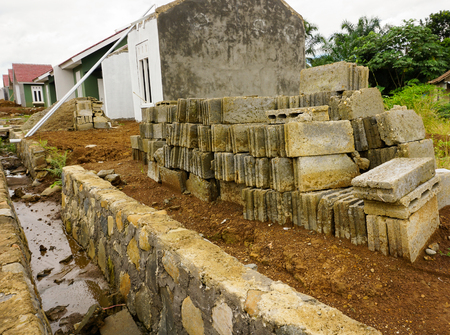 dwelling mound: Building concrete construction footing with rocks photo taken in Bogor Indonesia java Stock Photo
