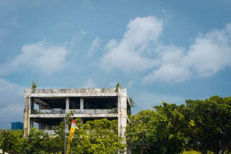 rooftile: Abandoned office building with trees and cloudysky photo taken in Jakarta Indonesia Stock Photo