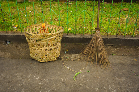 yard stick: Broom stick and trash basket made from bamboo photo taken in jakarta indonesia Stock Photo