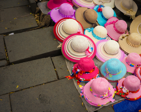 Pinky millinery and hats sold on the ground at Kota Tua Museum Area photo taken in Jakarta Indonesia Banco de Imagens