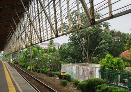 A view from Depok station forward to a green landscape with bog trees and bushes photo taken in Depok Indonesia Stock fotó