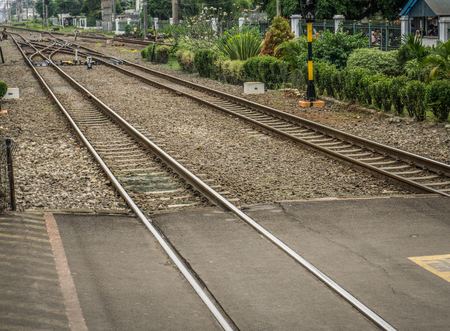 Crossing line for railways with bushes around photo taken in Depok Indonesia Stock fotó