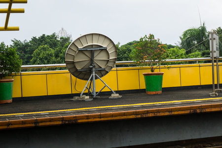 a parabola for signal telecommunication transmitter in train station photo taken in Jakarta Indonesia Stock Photo