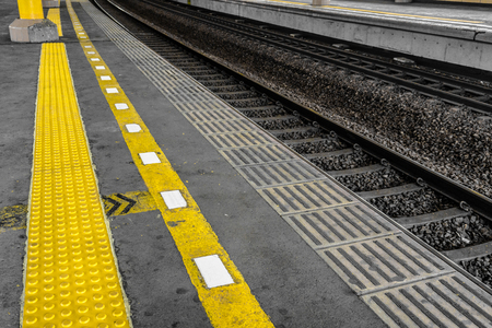 Yellow line for security line made from arise rubber for blind people in train station photo taken in Jakarta Indonesia
