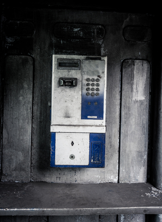 old photograph: old public telephone machine left with grunge photography style effect photo taken in Jakarta Indonesia Stock Photo