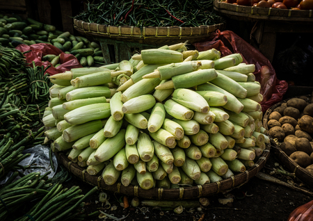 green bean: Baby corn stacked on top of bamboo webbing in the middle various kind of vegetables photo taken in Bogor traditional market