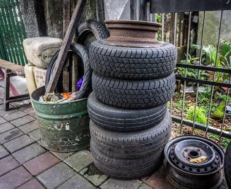 alloy: Stacked tire near a dust bin on side the street photo taken in Jakarta Indonesia