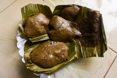 apam traditional dish from rice with leaf as cover from asia indonesia Stock Photo