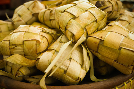 ketupat or tupat boiled rice traditional served in ied fitr for muslim day in asia indonesia Stock Photo